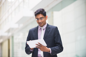 indian business male with a tablet