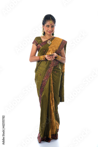 indian female in traditional clothes with lamp full body