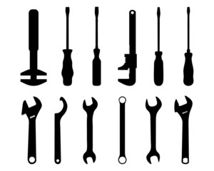 Black silhouettes of screwdriver and screw wrench, vector