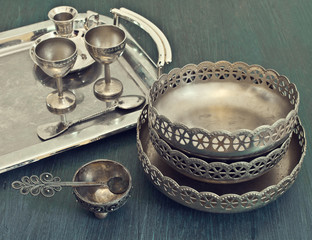 old silver utensils on a tray