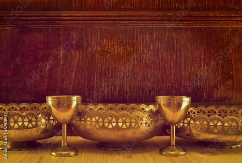 Still life with golden antique utensils