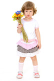 Beautiful little girl with beautiful hairstyle holds a bouquet o