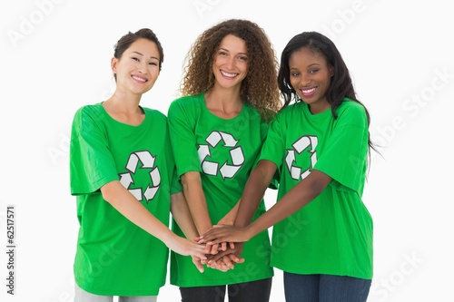 Team of environmental activists smiling at camera with hands