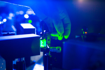 Quantum optics - hand of a researcher adjusting a laser beam in