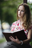 beautiful blond girl reading book