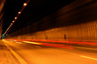 Car light trails. Art image . Long exposure photo taken in a tun