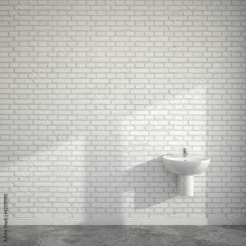 WC room with wash basin at empty wall of bricks
