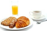 A cup of black coffee, breakfast bread and a orange juice
