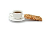 A cup of black coffee an a piece of breakfast bread