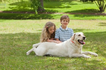 Portrait of kids with pet dog at park