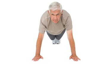 Portrait of a senior man doing push ups