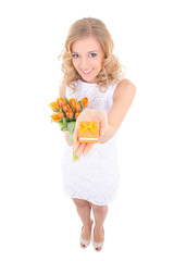 young slim woman in white dress with flowers and gift