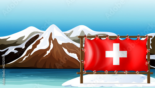 The flag of Switzerland at the sea