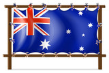 The flag of Australia attached to the wooden frame