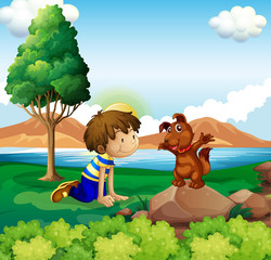 A young boy and his pet near the lake