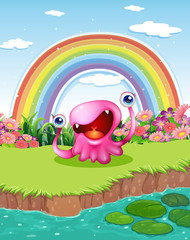 A monster at the pond with a rainbow in the sky