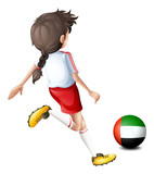 A player using the ball with the flag of the United Arab Emirate