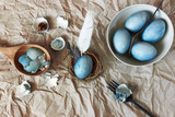 Still life with blue easter eggs with cutlery