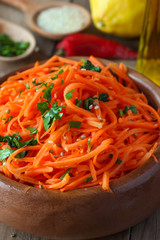 Korean-style spicy carrot salad with coriander and sesame seeds