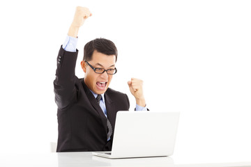 happy businessman raise his hands to celebrate victory