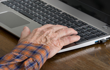 old man using laptop