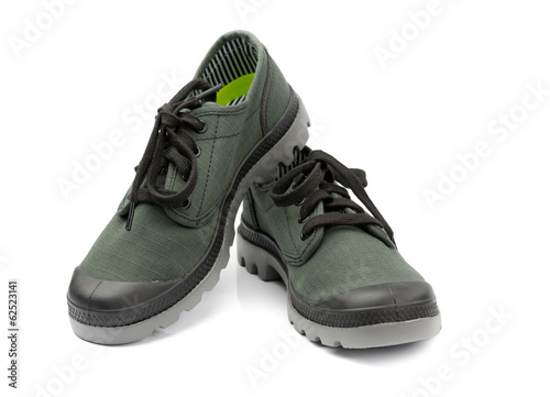 Fashionable pair of green sneakers. Isolate on white.