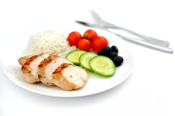 Fried chicken fillets, boiled rice and fresh vegetables