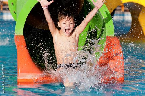 Leinwanddruck Bild Boy at aqua park