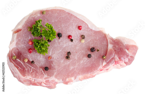 sliced raw pork steak with pepper and parsley isolated on white