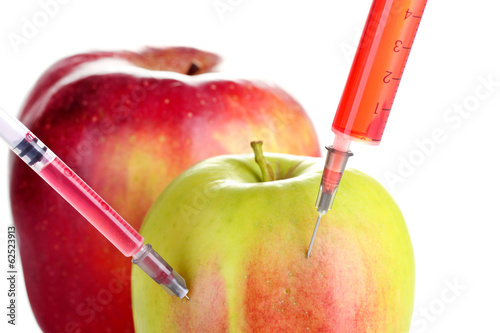 Injection into fresh apple isolated on white