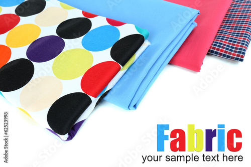 Pile of colored fabrics isolated on white