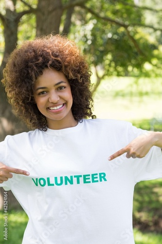 Environmentalist pointing at volunteer tshirt