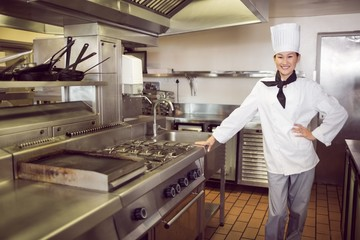 Smiling female cook in the kitchen