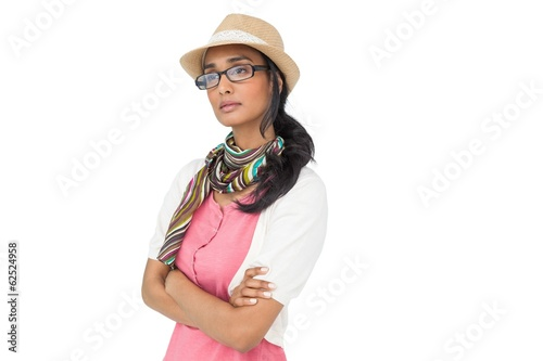 Serious cool young woman with arms crossed