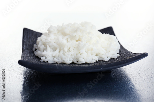 Cooked rice on grey background