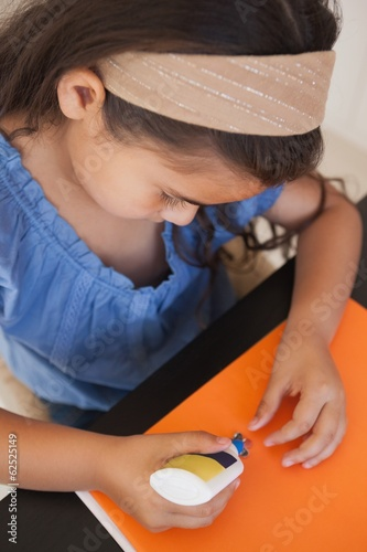 Close-up of a girl doing craftwork