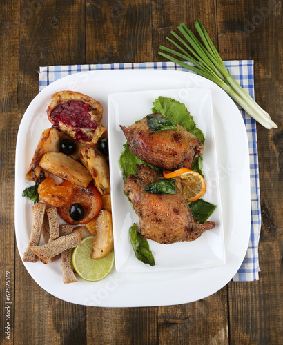 Homemade fried chicken drumsticks with vegetables