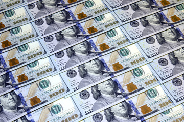 Background of one hundred American dollars banknotes