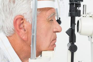 Senior man getting his cornea checked