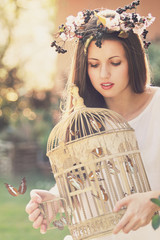 Vintage cage full of butterflies