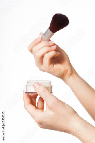 Woman applying a make-up