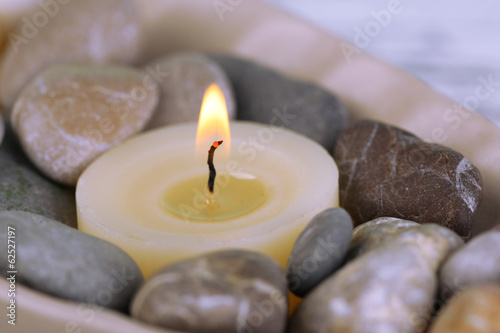 Spa stones and candle, close-up