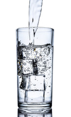 Glass of water with a splash and ice cubes