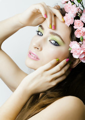 Beauty young woman with flowers and make up close up