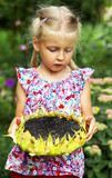 girl with the seeds of the sunflower