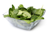 Glass bowl of fresh spinach