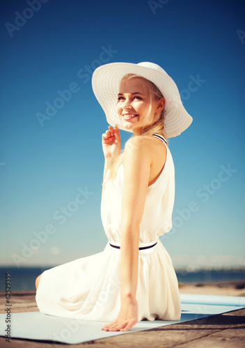 beautiful woman enjoying summer outdoors
