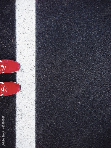 Red shoes on black road