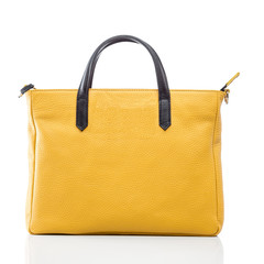 female yellow leather handbag