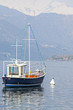 Recreational Boat moored on the lake color image